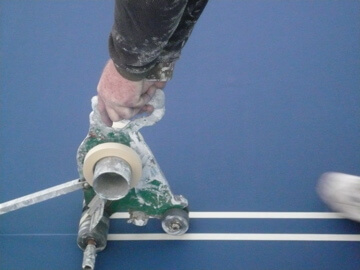 Laying out and painting playing lines on Courts in Easton Tennis Courts (2)